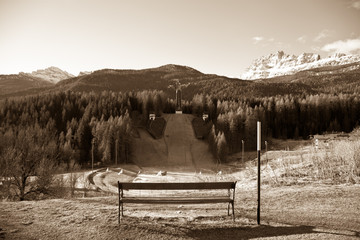 abandoned ski jump photographed in sepia tone