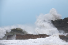Storm Waves Hit Cliff And Harbour At Portreath, Cornwall, UK