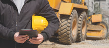 Construction Worker Using Tablet On The Site.