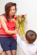 Son gives mother a bouquet of tulips