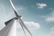 Leinwandbild Motiv Windkraft Anlage mit zartem Wolken Hintergrund und Freiraum für eigenen Text