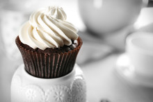 Delicious Chocolate Cupcake With Cream On Served Table, Close Up
