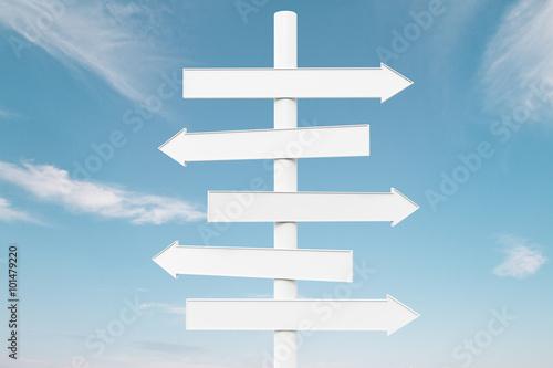 Fotografie, Obraz  White arrow signs on blue sky background