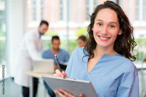 Fotografia  Portrait of a young attractive nurse at the hospital