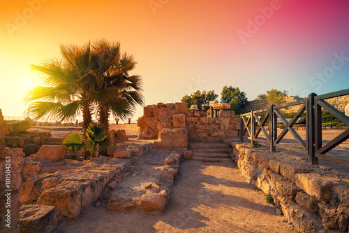 Foto auf Leinwand Dunkelbraun The ruins of the ancient city in Caesarea, Israel