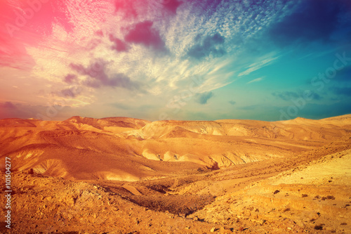 Staande foto Droogte Mountainous desert with colorful cloudy sky. Judean desert in Israel at sunset