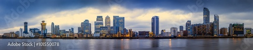Poster London Wide panoramic skyline of Canary Wharf, the worlds leading financial district at blue hour - London, UK