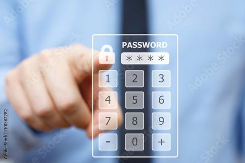 Fotografía  Business man pressing security code on virtual keypad
