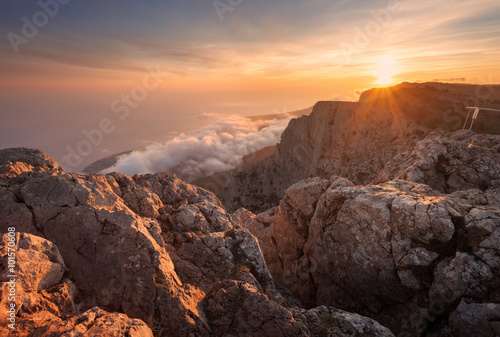 Foto op Aluminium Diepbruine Beautiful landscape on the top of mountains with low clouds at sunset. Nature background