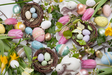 FototapetaAssorted eggs and flowers for Easter on white