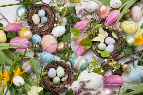 Assorted eggs and flowers for Easter on white - 101574616