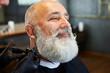 bearded smiley man in barber shop