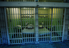 Prison Cell Behind The Bars In...