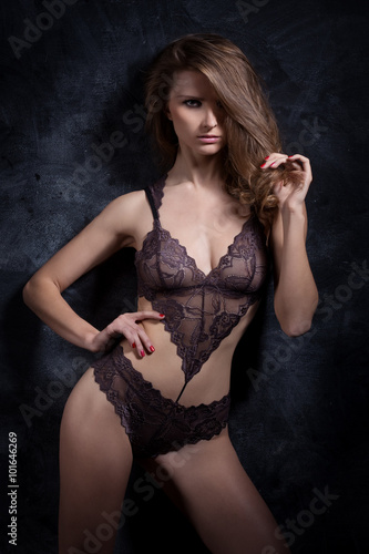 691f9850f beautiful fashionable sensual sexy girl in lingerie with lace in the studio  on a black background