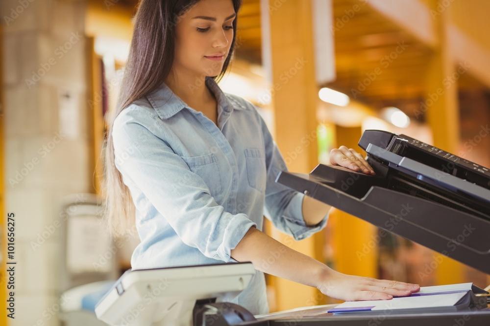 Fototapety, obrazy: Smiling brunette student making a copy