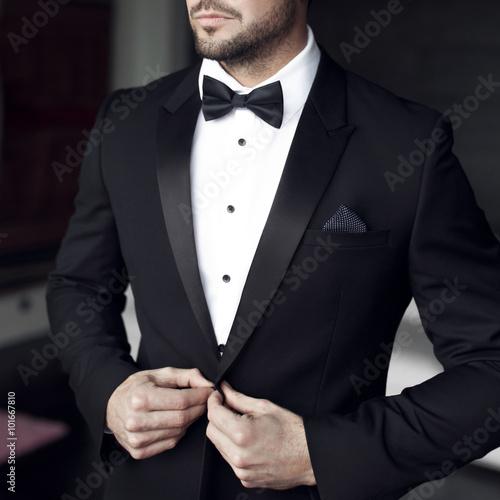 фотография  Sexy man in tuxedo and bow tie