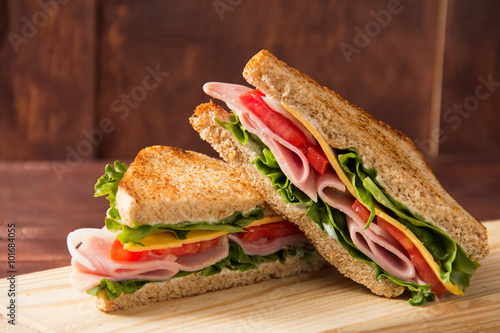 Tuinposter Snack Sandwich bread tomato, lettuce and yellow cheese