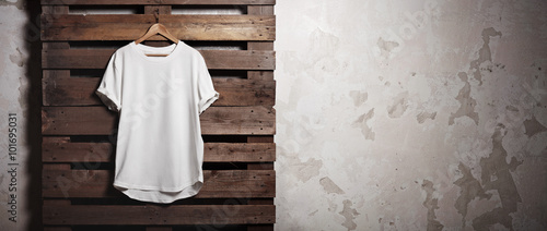 Obraz Photo white tshirt  hanging in front of concrete wall. Wide - fototapety do salonu