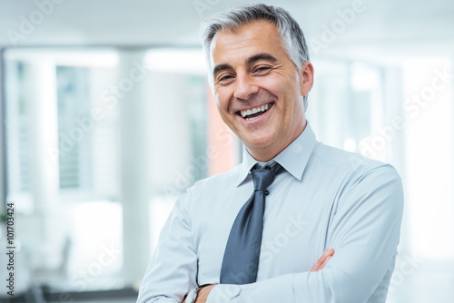 Successful businessman posing