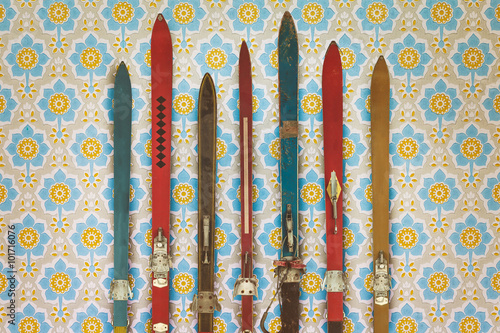 vintage-colorful-used-skis-in-front