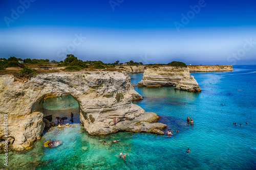 Stacks on the coast of Salento in Italy Wallpaper Mural