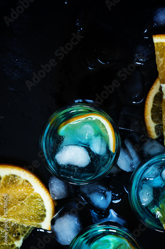 blue-cocktail-with-blue-curacao-liqueur-and-orange-top-view-se