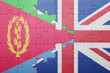 canvas print picture - puzzle with the national flag of great britain and eritrea