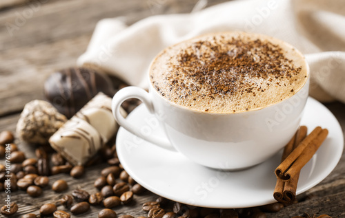 Hot coffee and pastries on a wooden background