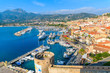 CALVI, CORSICA ISLAND - JUN 29, 2015: view of boats and colorful houses in Calvi port. This town has luxurious marina and is very popular tourist destination.