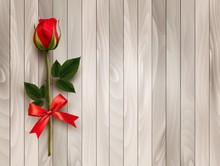 Happy Valentine's Day. Beautiful Red Rose And Gift Bow On Wooden