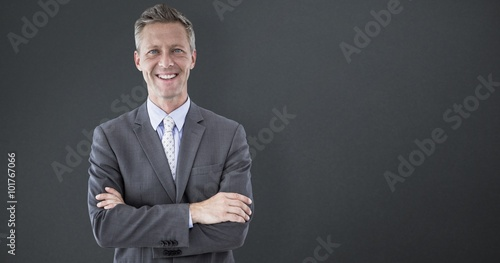 Composite image of smiling businessman sith arms crossed Canvas Print
