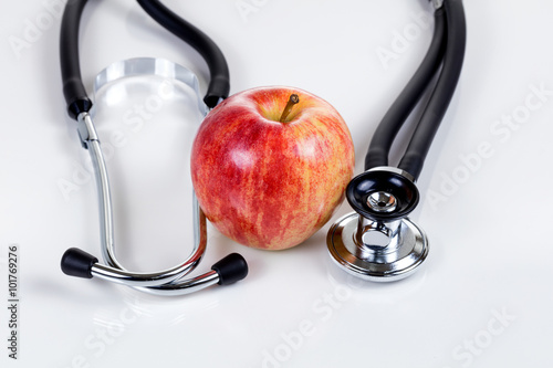 Good health with fresh red apple and stethoscope Poster