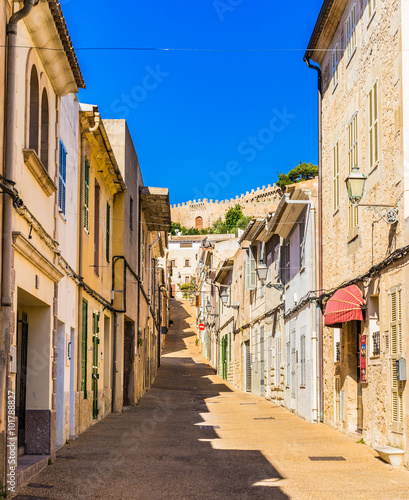 Fototapety, obrazy: View of a old town street with an historical fortification at background