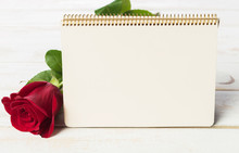 Blank Card With Red Rose On A Wooden Background