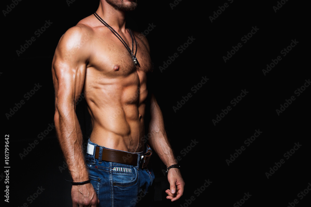 Fototapeta Muscular and sexy torso of young man in jeans