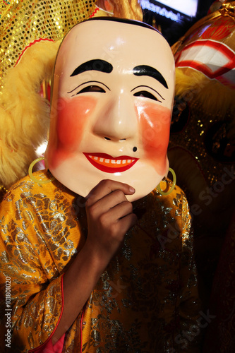 """2947feb66 Pink-faced Buddha """"happy face,"""" """"old man,"""" or monk-masked parade  participants lead the lion dancers ,Chinese New Year Bangkok , Thailand"""