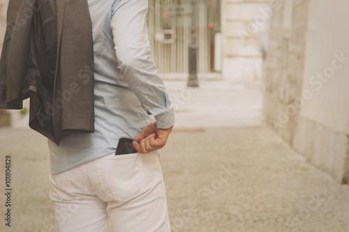 Fotografía  Handsome elegant man using smartphone.