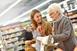 canvas print picture - Elderly woman with young woman at the grocery store