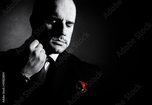 Tablou Canvas Black and white portrait of man, godfather-like character.