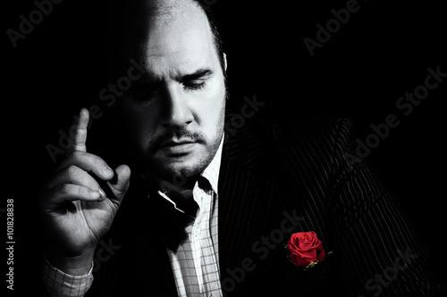 Obraz na plátně  Black and white portrait of man, godfather-like character.