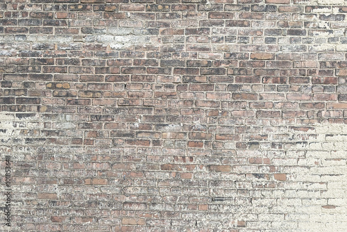 Staande foto Baksteen muur Old red brick wall with white paint background texture