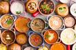 Leinwanddruck Bild - Variety of Garnished Soups in Colorful Bowls