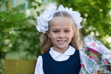 First Grader Girl With Flowers, Russia