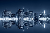 Fototapeta New York - Manhattan at night with reflections on Harlem river