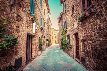 Fototapeta Narrow street in an old Italian town of Pienza. Tuscany, Italy. Vintage