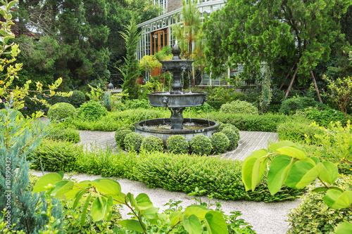 Fountain In English Garden Design.