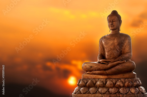 Foto auf Leinwand Buddha Buddha and sunset