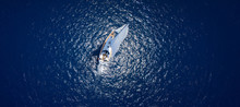 Amazing View To Yacht Sailing In Open Sea At Windy Day. Drone View