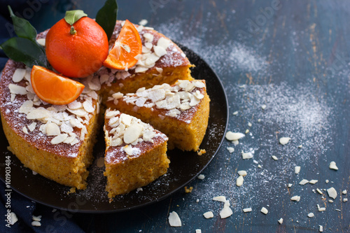 tangerine and almond cake on dark blue background, Canvas Print