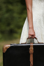 A Female Hand With A Suitcase